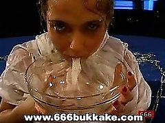 horny bitch drinks a bowl full of spunk